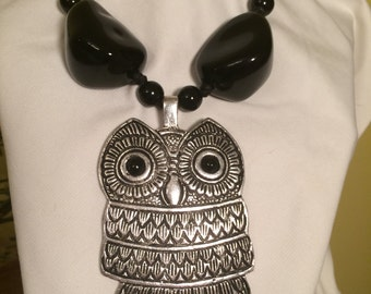 Owl metal necklace. 23 inch pull- back  closing leather string. Owl is 3 1/2 inch