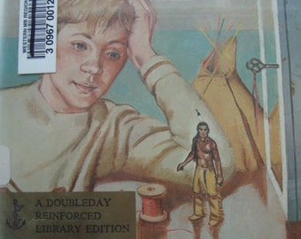 The Indian in the Cupboard - 1980 Doubleday Reinforced Library 1st Edition by Lynn Reid Banks. Childrens Story Book with Illustrations.