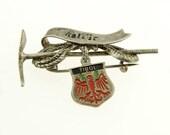 Vintage Austrian charm souvenir brooch from Tirol, ski and mountains