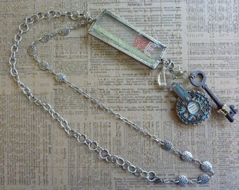 """Inspirational """"WE Hope"""" Found Objects Necklace with Key, Rhinestones, Dictionary Pages,""""WE""""Pendant,Quote,Clear Bead, 30"""" Silver/Pewter Chain"""