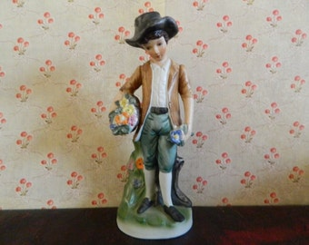 Boy Holding Basket Of Flowers Figurine