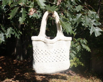 Fully lined Mid sized hand crocheted purse/tote in cream.