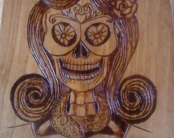 Dios De Los Muertos Plaque. 8 in x 10 in. Oak stain