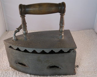 Antique Victorian charcoal box iron with wooden handle.
