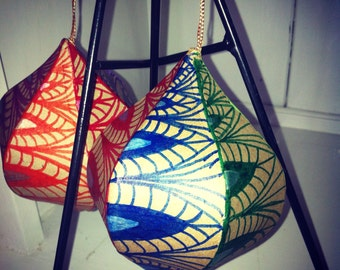 Pair of rainbow hand-decorated ornaments