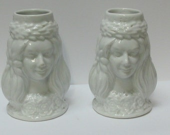 Pair of ceramic jars with a woman face on both sides
