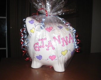 Hearts hand painted piggy bank personalized with name.