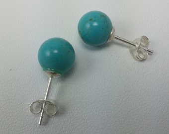 Turquoise colored ball earrings