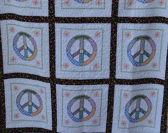 Peace sign cross stitched quilt