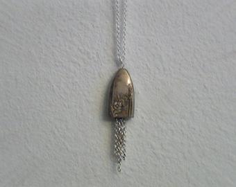 Antique silver knife handle makes this necklace unique.