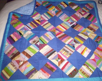 multi coloured lap/sofa quilt