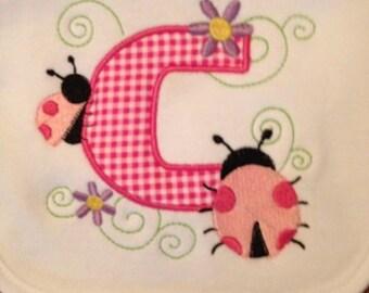 Monogram Ladybug Bib