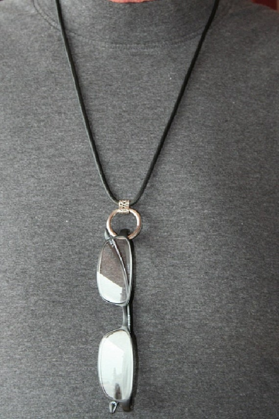 Eye Glass Loop.  This is a sterling silver eyeglass loop that hangs from a leather cord with sterling silver end caps and clasp