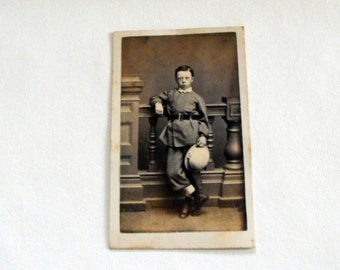 1800s photo of young boy in unusual outfit
