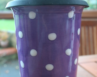 Ceramic travel mug hand decorated with polka dots (purple and white)