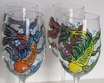 Items similar to hand painted wine glass fish yellow and for Painted glass fish