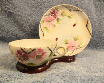 CUP AND SAUCER floral with raise enamel decoration made in japan