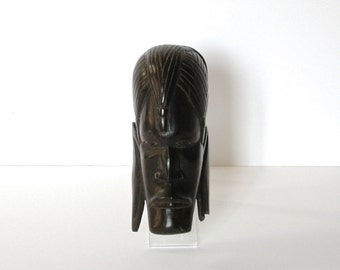 Wood craft carving of african head, 1930s