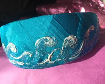 Headband covered with turquoise organdy and satin