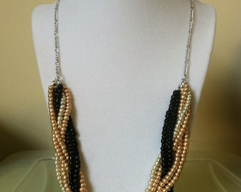 Gold and Black Beaded Braided Necklace with a Toggle Clasp