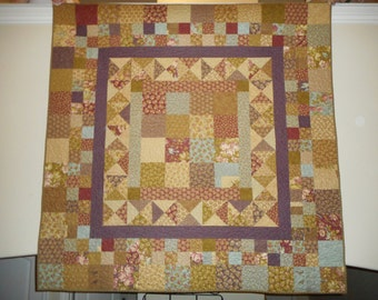 Cozy pieced lap quilt in muted colors