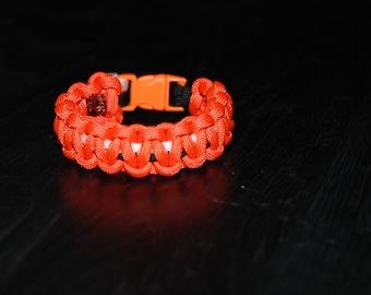 Paracord Survival Bracelet with Clip - Orange, Black, and White