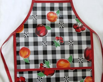 Adorable Kids Oilcloth Apron Fits Sizes 4-7-Full Or Double Pocket-Wipes Clean With Damp Cloth-Ties in back-Black Check With Fruit Pattern
