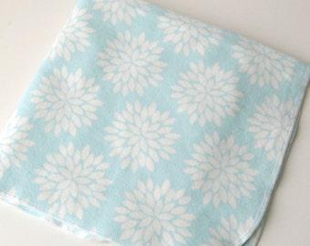 Flannel baby blanket with modern flower print