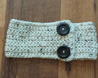 Crocheted earwarmer headband with buttons.