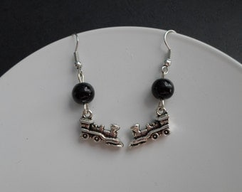 Train earrings with beads.