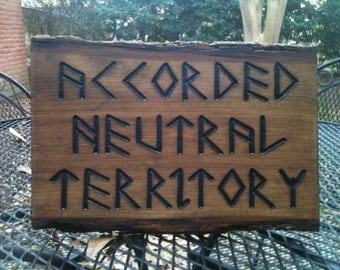 Dresden Files Accorded Neutral Territory burned wood sign