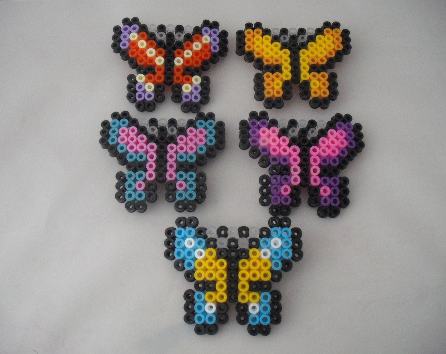 various butterfly hama bead hair slides by