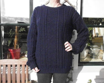 Blue cable sweater, for example.