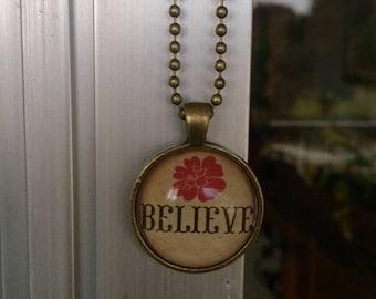"Glass pendant necklace - ""Believe"" - round - bronze"