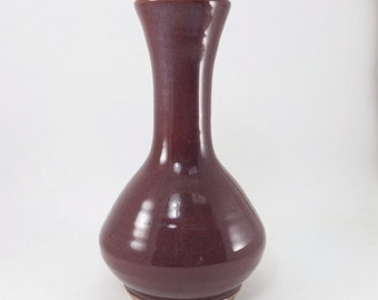 red flower vase or bottle