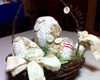 Antique Quilted wrapped Easter eggs in nest basket decoration