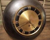 Free Shipping Old Brass Clock with fleur de lis decoration and roman numeral face as-is