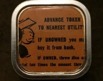 ADVANCE TOKEN - Vintage Monopoly Chance Altered Tin/Pill Box