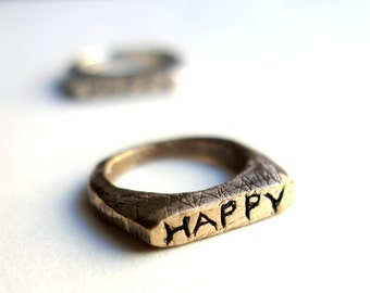 Hand carved Happy Rings in Bronze