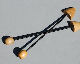 two springy shoe stretchers wood and metal