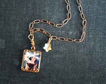 One of a kind collage pendant set under resin on copper necklace. Miniature scene. Alphonse Mucha fine art painting.