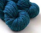 Hand Dyed Worsted Yarn - Zenith - Superwash Merino 218 Yards - Dark Semi-Solid Blue
