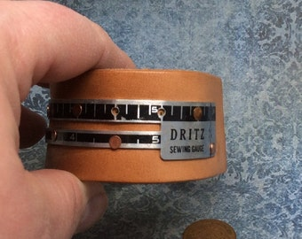 Real Steampunk handmade leather cuff and vintage sewing gauge - Mechanical Romance -