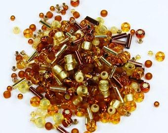 30g Toho Japanese Glass Seed Beads - # 3219-Kohaku-Amber Mix
