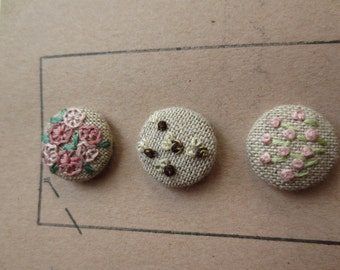 Flower bed buttons with bees