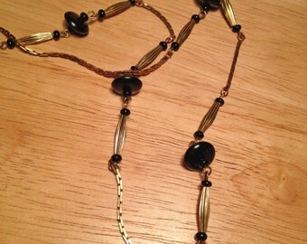 vintage black and brass beaded necklace