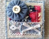 Denim and floral pin brooch with yoyo button topper