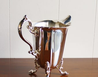 Vintage footed silver plated water pitcher