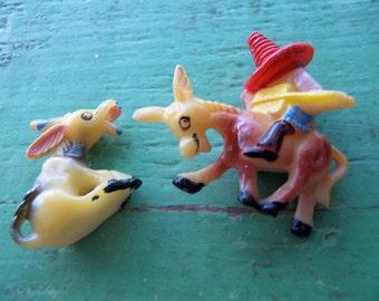 two happy plastic donkey figurines