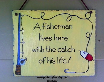 A fisherman lives here with the catch of his life hand painted decorative Slate Sign 7 x 9